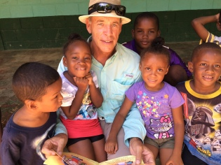David reading to the school kids at the school we built on the island of St. Helene.